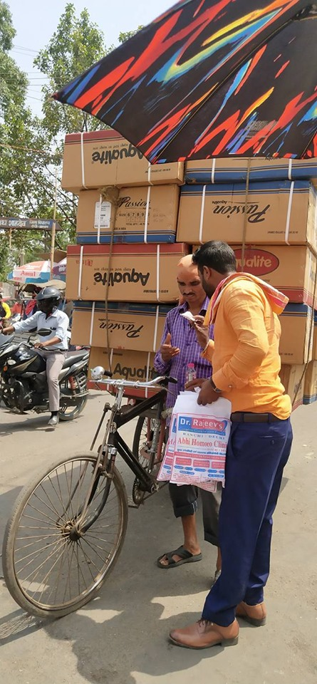 Distributing Sunstroke Medicine, water Bottles, Towels, and Health Tonic to all Traffic Police, Rickshaw Drivers, Automobiles, and common people.